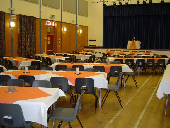 A picture of the main hall laid out with tables